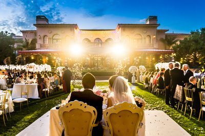 Bride and groom looking upon their guests   at The Fairmont Grand Del Mar.